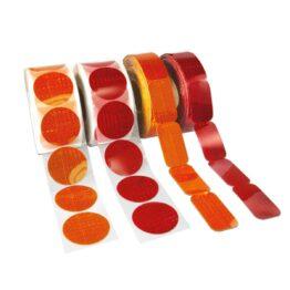 Reflectores adhesivos con lentes prismáticas