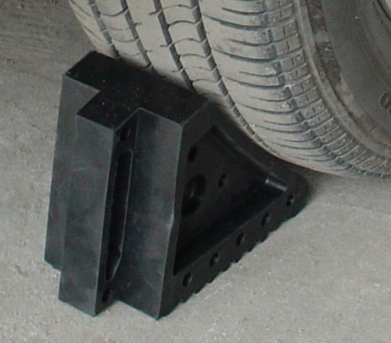Cuña adhesiva para ruedas de vehículos